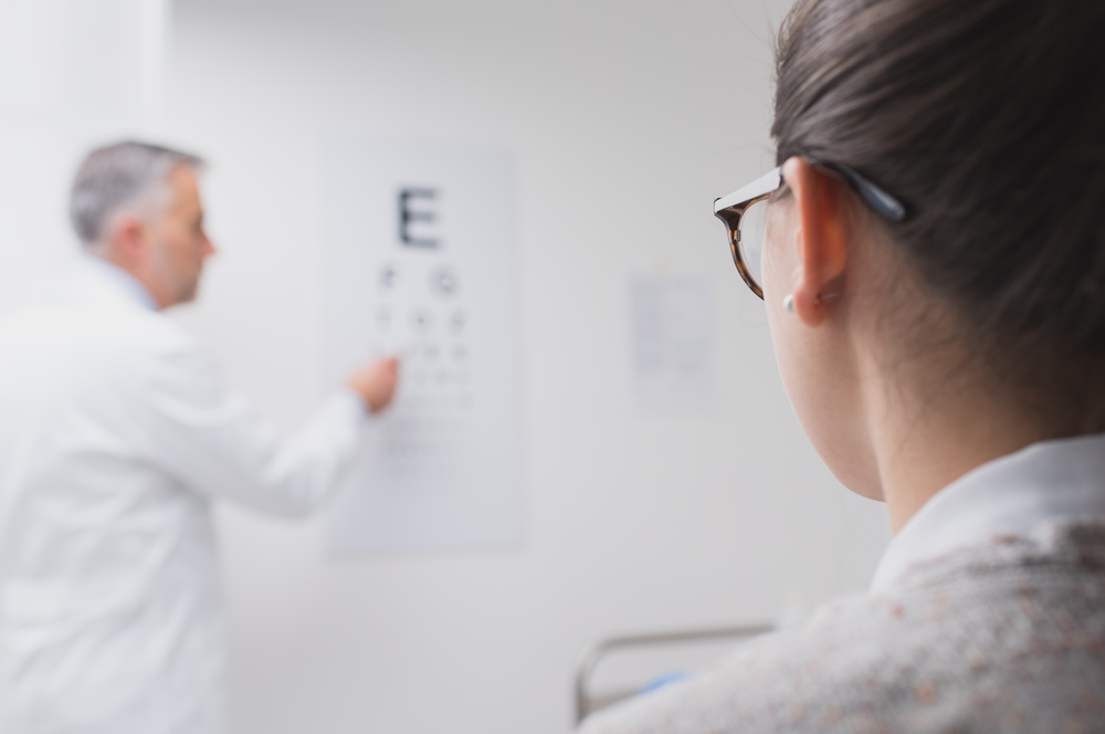 Woman getting eye exam by optometrist